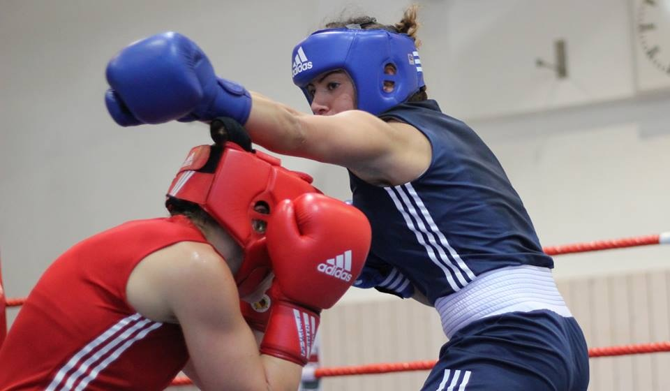 Shelley Watts (red) in the ring as she prepares to don the green and gold in Glasgow.