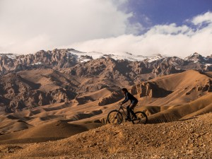 Shannon riding through Afghanistan. Photo: Deni Bechard