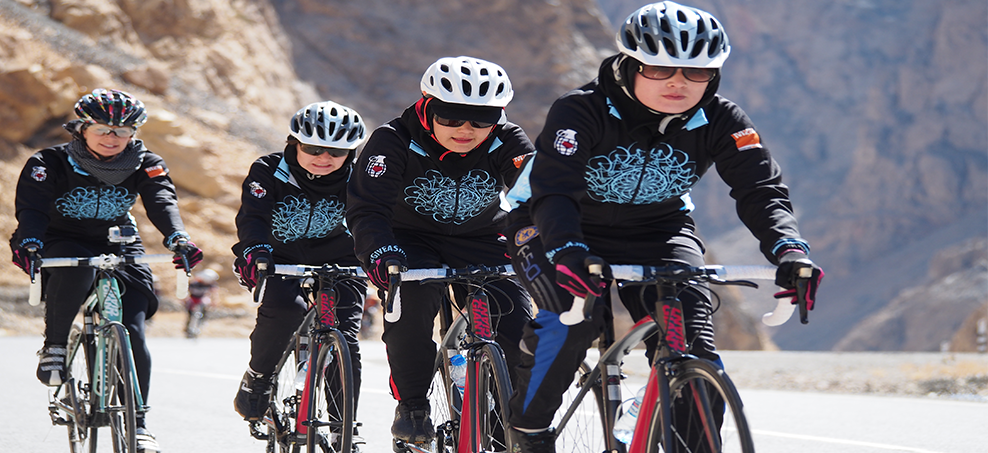 Mountain2Mountain Founder Shannon Galpin with the Afghanistan National Women's Cycling Team Photo: Deni Bechard