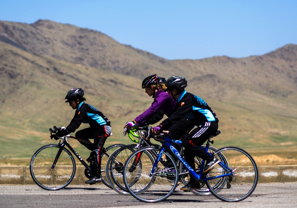 Shannon riding and coaching the Afghan Women's Cycling Team. Photo: Deni Bechard