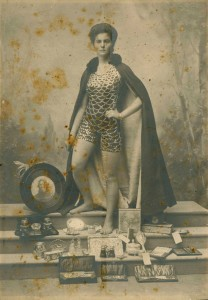 Studio portrait of Beatrice Kerr with her collection of prizes, c 1905. Australian National Maritime Museum collection.