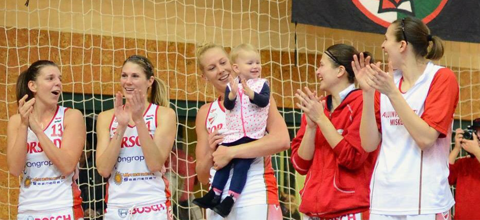 Abby Bishop  and 18 month old Zala with her teammates following their match in Hungary.